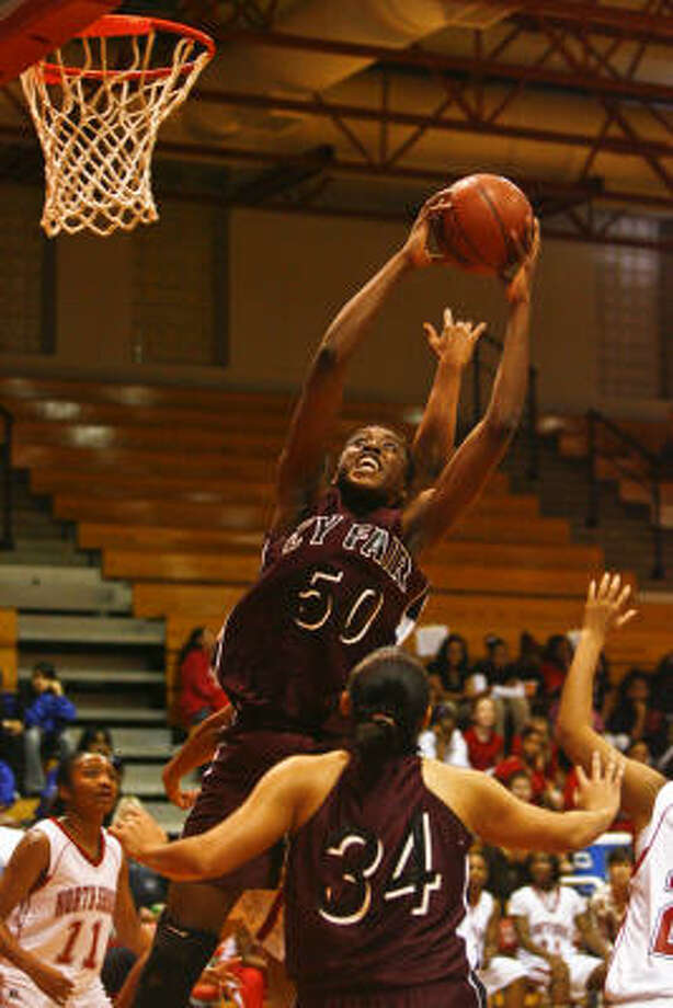 Cy Fair's Chiney Ogumike pulls down a rebound against North Shore during the first half. Photo: Michael Paulsen, Chronicle