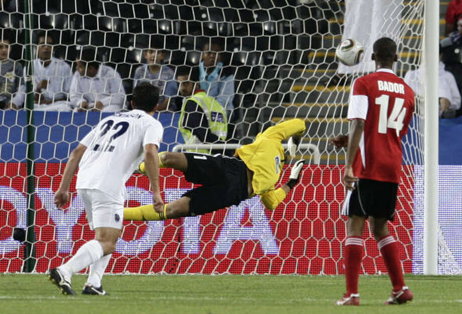 Al Ahli goalkeeper Yosif Abdalla can't stop Auckland City's second goal on Wednesday. Photo: Bernat Armangue, AP