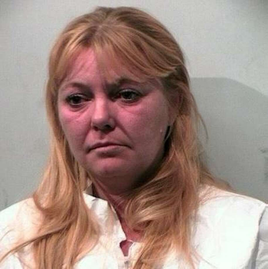 Tanya Lin Schmidt is charged with murder in the triple shooting of two neighbors and her own husband. One of the neighbors died from her injuries. Photo: Pasadena Police Department