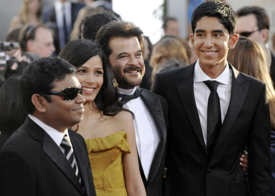 "The cast of ""Slumdog Millionaire"" basks in the Hollywood glow on the red carpet before winning four Golden Globes on Sunday. Photo: Chris Pizzello, Associated Press"
