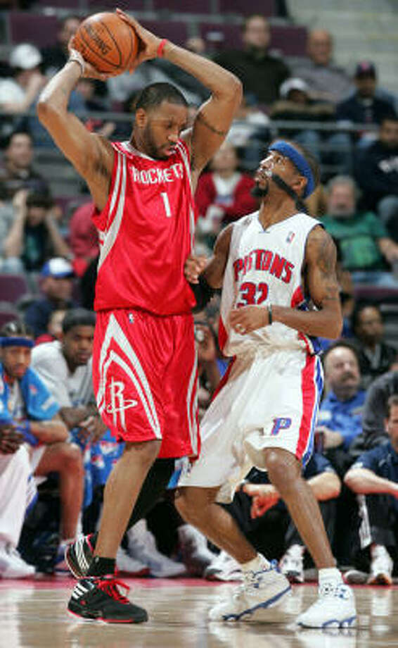 Tracy McGrady, playing for the first time since Jan. 9, encounters the Pistons' Richard Hamilton. McGrady scored 15 points in 37 minutes of action. Photo: Kirthmon F Dozier, MCT