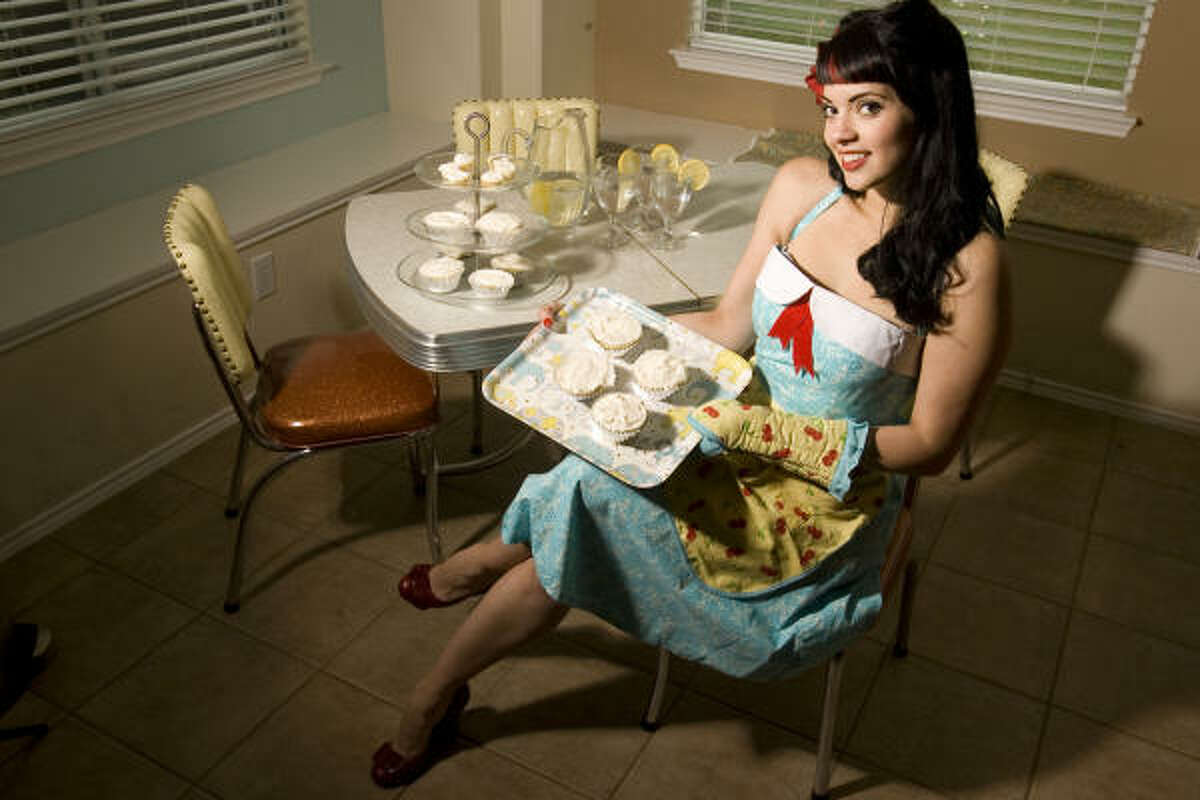 """Veronica """"Miss V"""" Orso-Flores is a mother, a human-resources administrator and part-time pinup model. """"It's all dress-up,"""" Orso-Flores said of her love for the retro-glam look."""