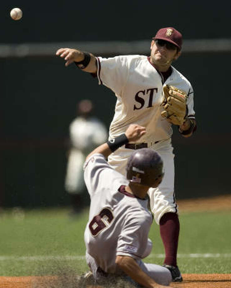 Texas State second baseman Kyle Livingstone forces Boston College's Matt Hamlet at second to begin a double play in the eighth inning. Photo: Jay Janner, AP