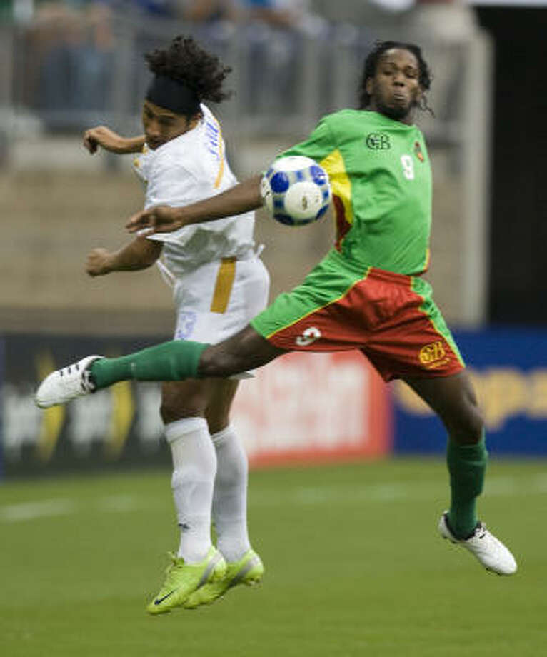 Guadeloupe's Ludovic Gotin (9) and Nicaragua's Silvio Aviles (3) go up for a ball during the first half. Gotin scored in the second half. Photo: Brett Coomer, Chronicle