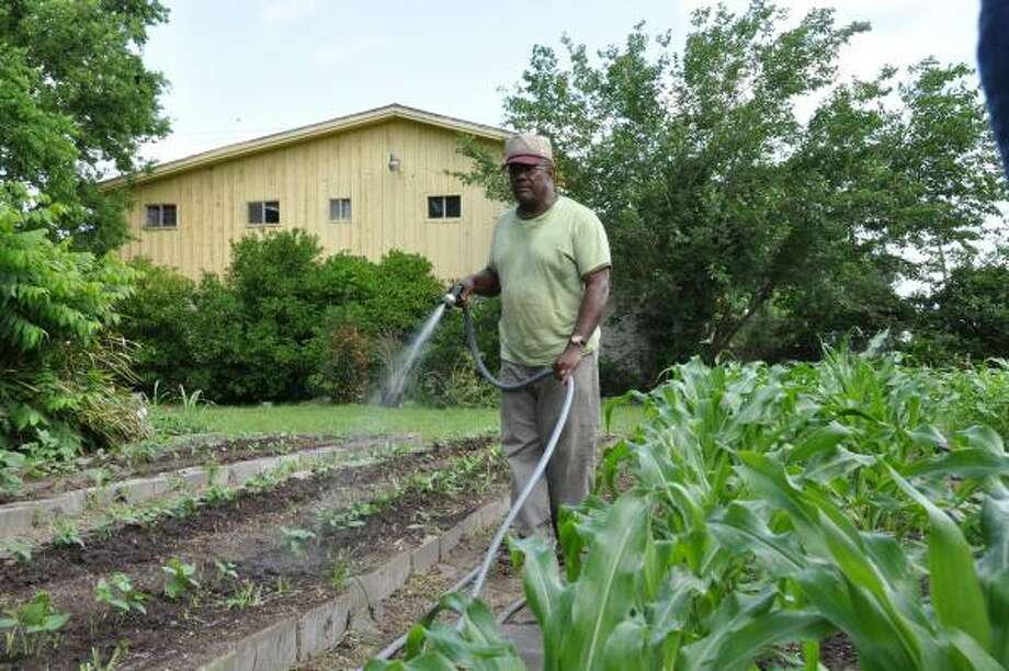GARDEN MENTOR: James Phillips of the Farmer Street Garden in Fifth Ward is always ready to help others learn to garden.