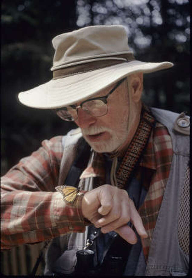 John Tveten watches a butterfly at the El Rosario Monarch Reserve in central Mexico in 1997. Photo: For The Chronicle