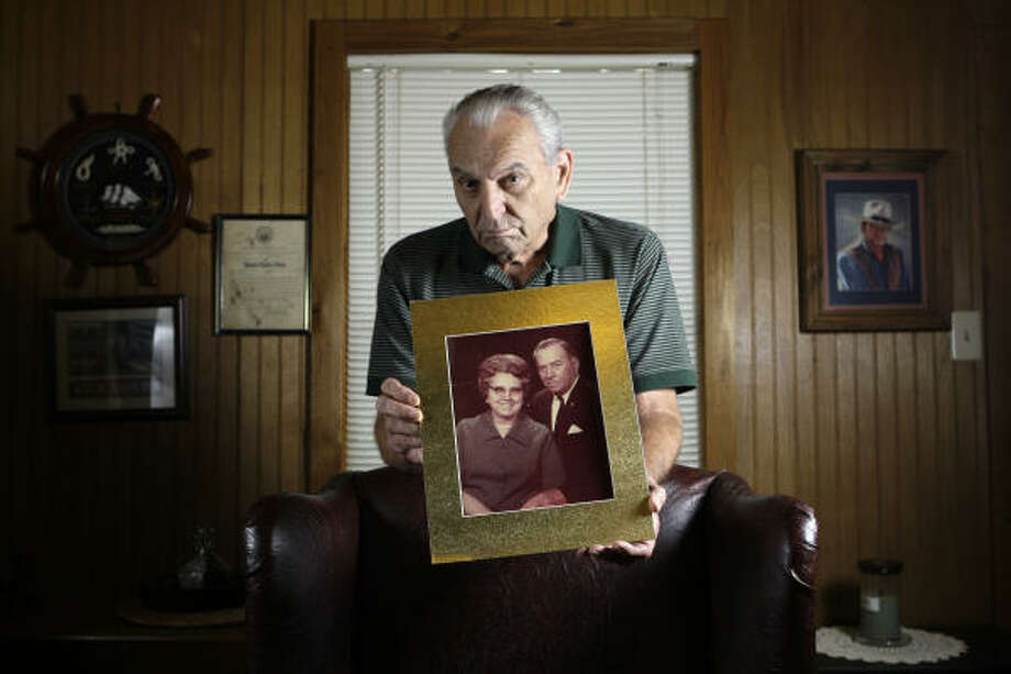 Raymond Nash, with a 1981 photo of his mother, Lillian Gertrude Nash, and father, Raymond Lee, has waited almost 25 years for a break in his mother's death. Police have now charged a man. Photo: Melissa Phillip:, Chronicle