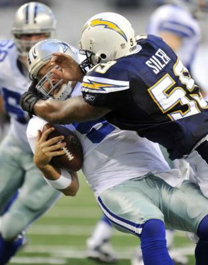 Cowboys quarterback Tony Romo is sacked by Chargers linebacker Brandon Siler in the first half. Photo: Michael Thomas, AP