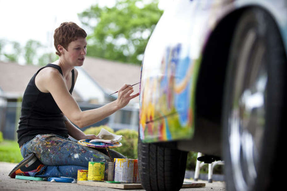Robynn Sanders paints Psychedelic Surfer Dude, a restored 1963 Porsche 356 owned by David Duthu, in preparation for the 2009 Houston Art Car Parade. Photo: Todd Spoth, For The Chronicle