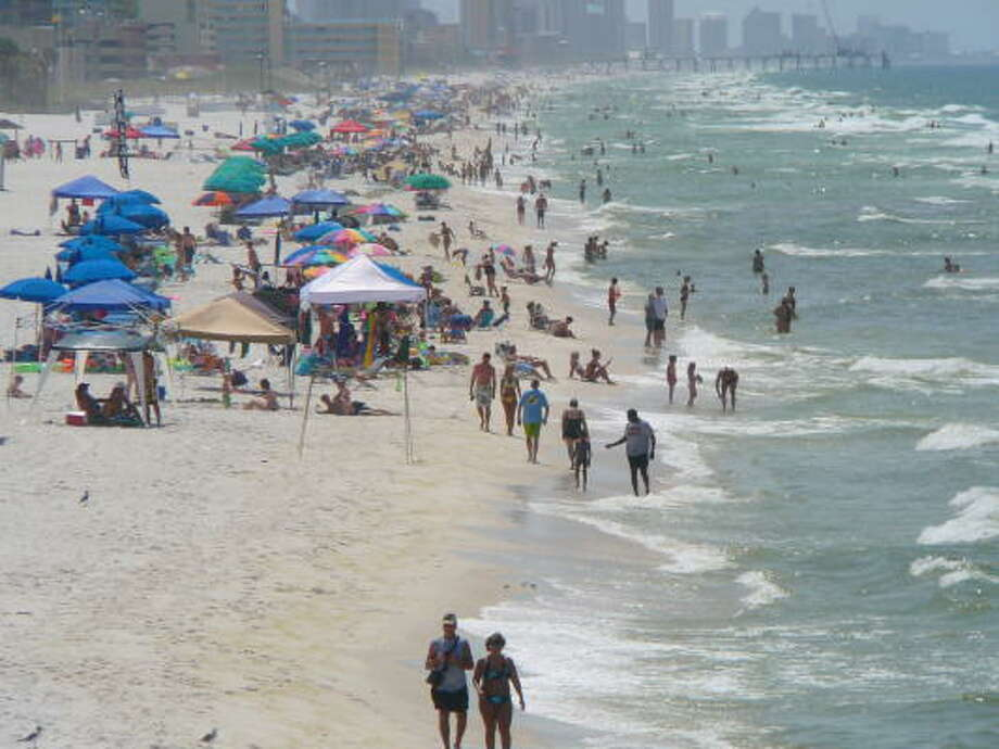 There's more than arcades in Panama City Beach. Its beaches draw thousands yearly. Photo: Jim Kiest, Staff