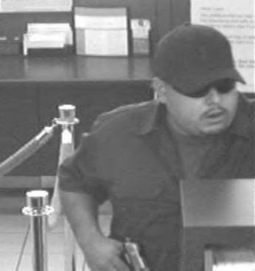 Authorities are searching for man who they say has robbed a bank at gunpoint in Hedwig Village along Interstate 10 on Tuesday. Photo: Surveillance Photo