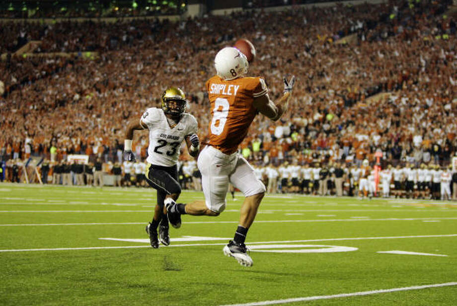 Texas receiver Jordan Shipley pulls in a long touchdown pass ahead of Colorado's Jalil Brown in the second quarter. Photo: Brian Bahr, Getty Images