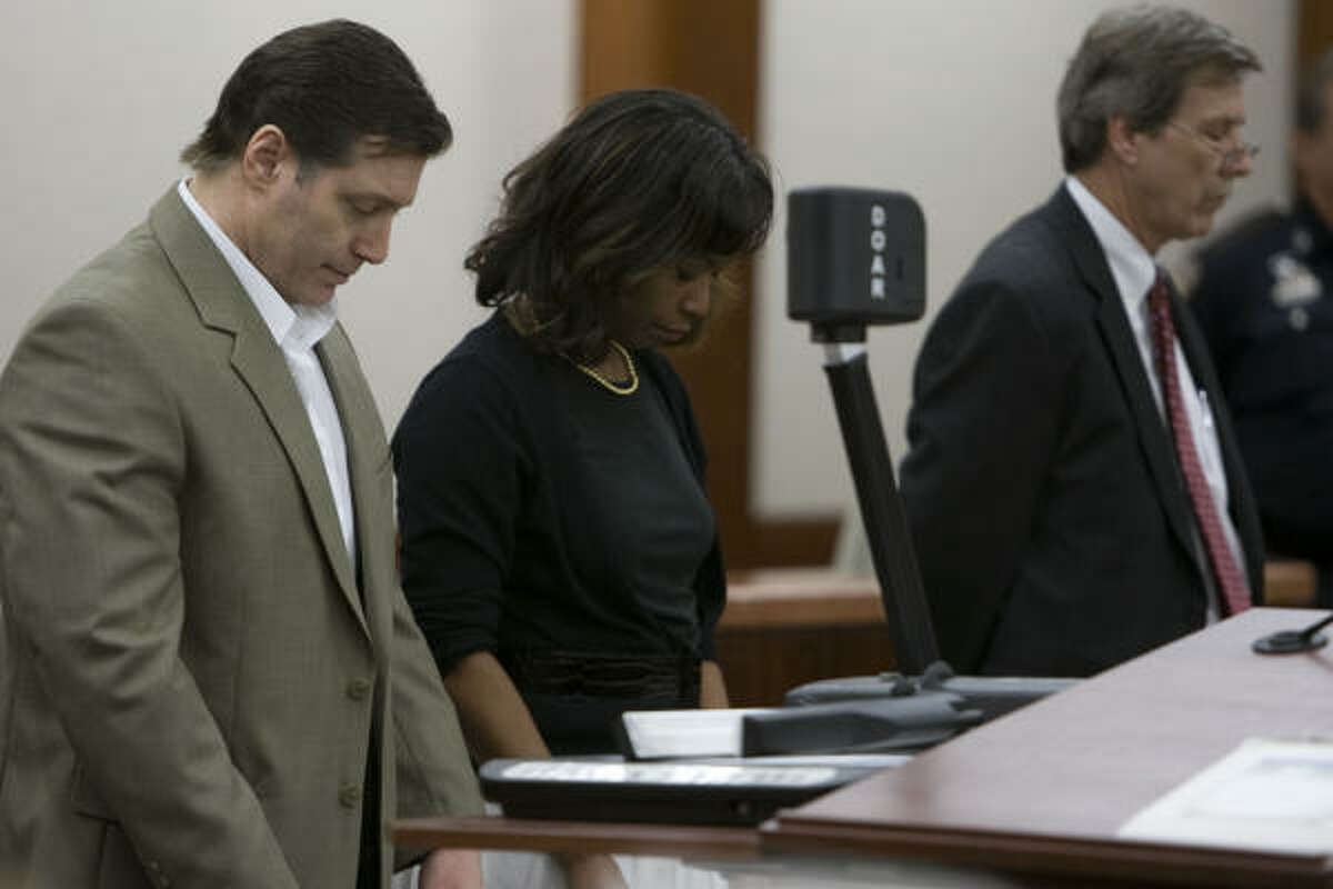 Robert Fratta, left, stands with his lawyers, Vivian King and Randy McDonald, as the decision is read Saturday.