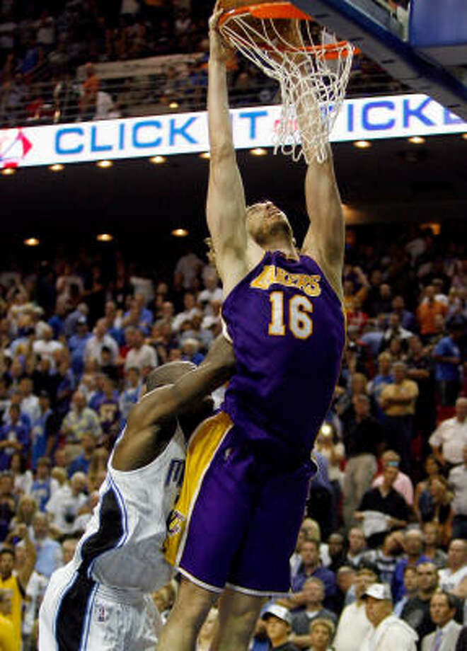 Lakers forward Pau Gasol gets fouled late in overtime by Magic guard Mickael Pietrus. Photo: Chris Graythen, Getty Images