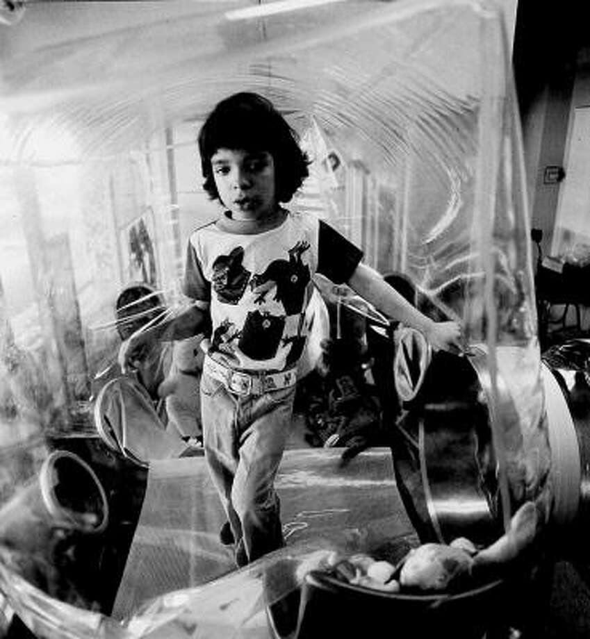 David Vetter, in his bubble at the age of 5, had a rare condition that left his body defenseless against infections. Photo: AP