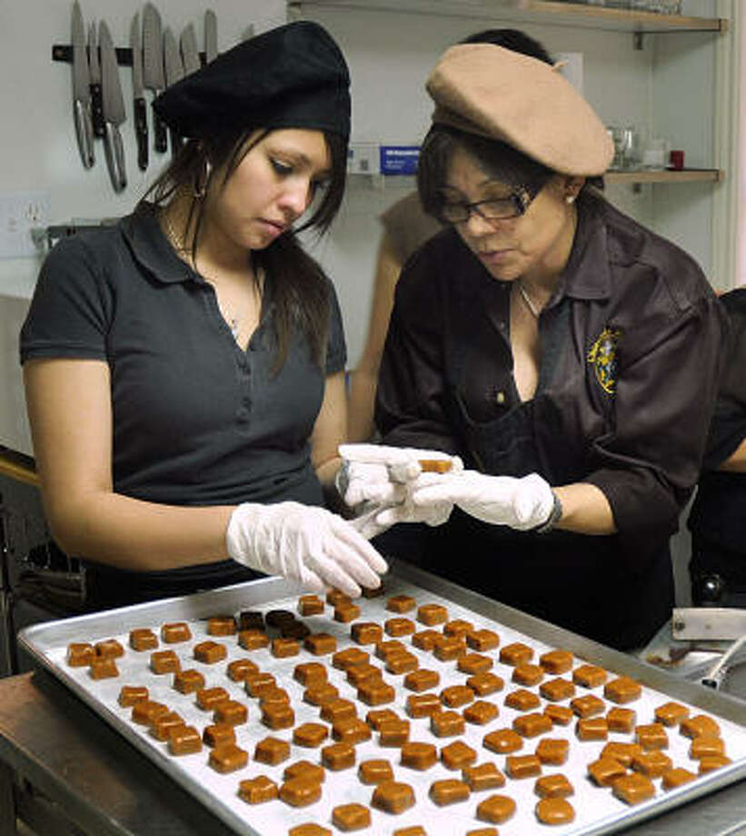 Leyda Reyes and Zulay Quinn hand make caramel treats at Chocolate Passions, 1520 N. Frazier in Conroe. The store is making extra treats for Valentine's Day. Photo: David Hopper, For The Chronicle