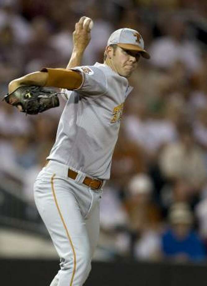 Texas pitcher Austin Wood throws one of his 169 pitches in the 25 inning game against Boston College. Photo: AP