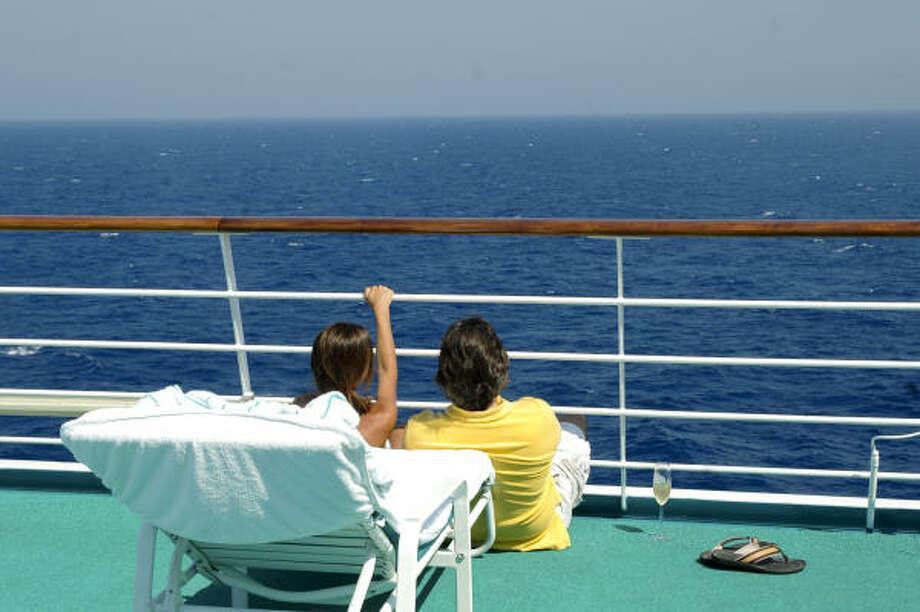 Crystal Serenity passengers, swim, sunbathe or just enjoy the view. Photo: JOAN SHATTUCK
