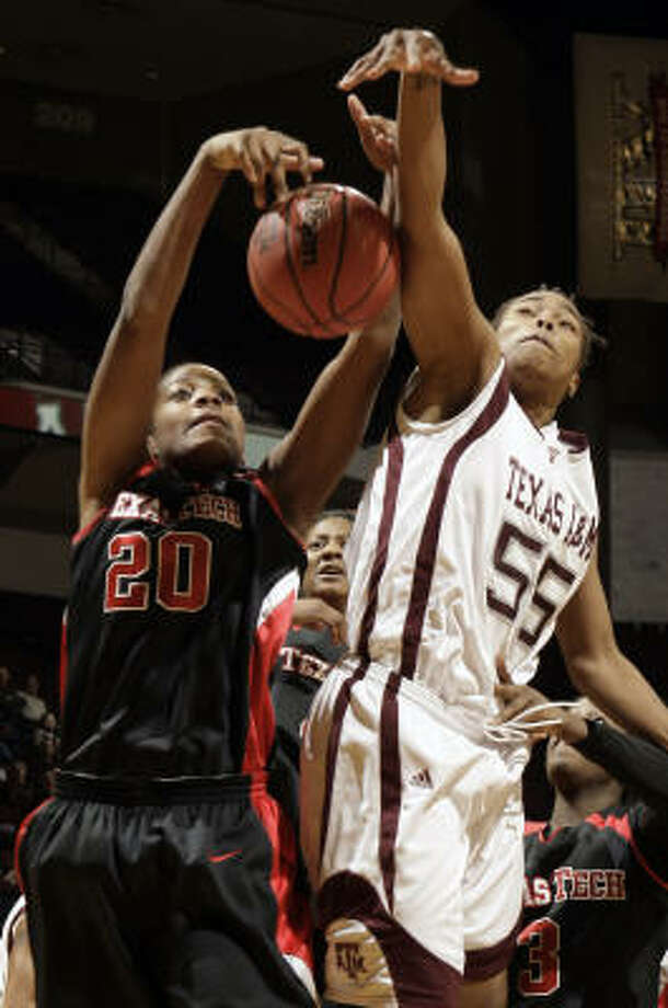 Texas A&M's Danielle Gant and Texas Tech's Kierra Mallard battle for a rebound during the first half on Tuesday. Photo: David J. Phillip, AP