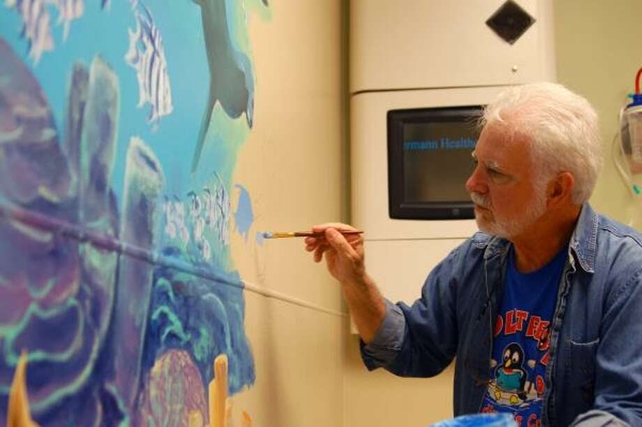 George Bevill paints underwater scenes on the walls of the pediatric wing of Memorial Hermann Sugar Land Hospital  Feb. 10. Photo: Joshua Winata, For The Chronicle