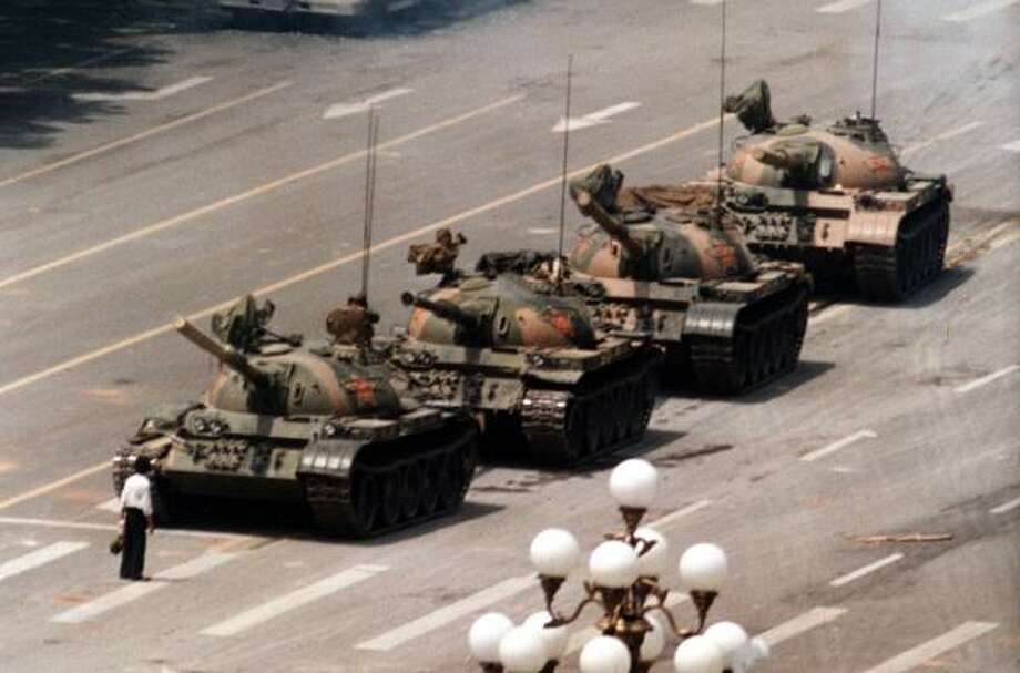 On June 5, 1989, a Chinese pro-democracy protester blocked a line of tanks heading east on Beijing's Cangan Boulevard in front of the Beijing Hotel. This week marks the 20th anniversary of the Chinese military assault on demonstrators in Tiananmen Square. Photo: JEFF WIDENER, AP