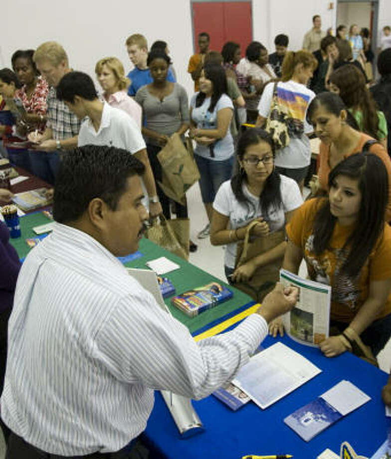 Miguel Brisen pitches Texas A&M-Kingsville to students during a college fair at Bellaire High School. People who apply to college by November have the best shot at scholarships and other financial assistance, experts say. Photo: Brett Coomer, Chronicle