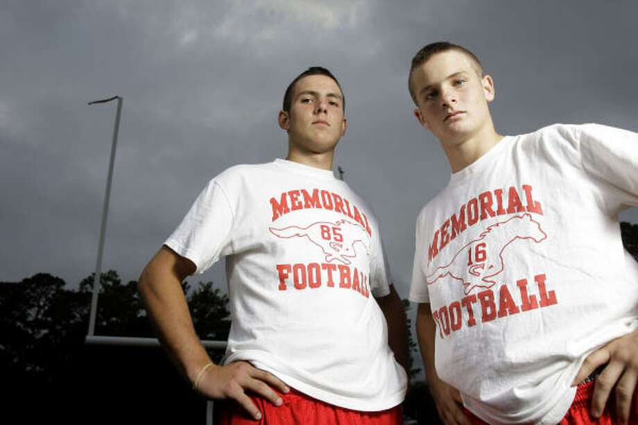 Memorial football players George Strake, left, and cousin Brad play Saturday against the school named for their great grandfather — Strake Jesuit. Photo: Melissa Phillip, Chronicle