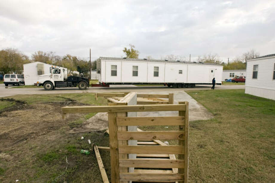 A FEMA trailer is towed away Wednesday from a mobile home park in Bacliff, where residents complain of intense pressure to move out before Christmas. Photo: James Nielsen, Chronicle