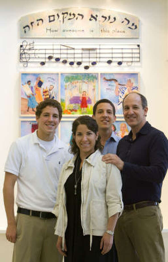 Jay Steinfeld, right, and his children — Alec, Esther and Craig Steinfeld — had an art memorial created to honor Naomi Steinfeld, who died in 2002. The artwork is displayed in the Jewish Community Center's lobby. Photo: BILLY SMITH II, CHRONICLE