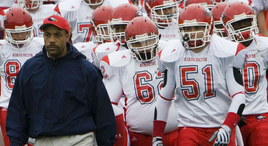 Atascocita head coach Dean Colbert leads his team onto the field before Saturday's second-round game against Katy. Photo: Smiley N. Pool, Chronicle