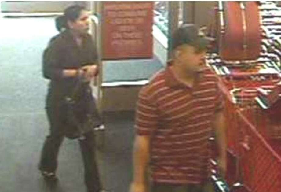 A store security camera photographed Alberto Acevedo and an unidentified woman at a Target store where he is accused of beating an employee who suspected the couple of shoplifting. Photo: Crime Stoppers