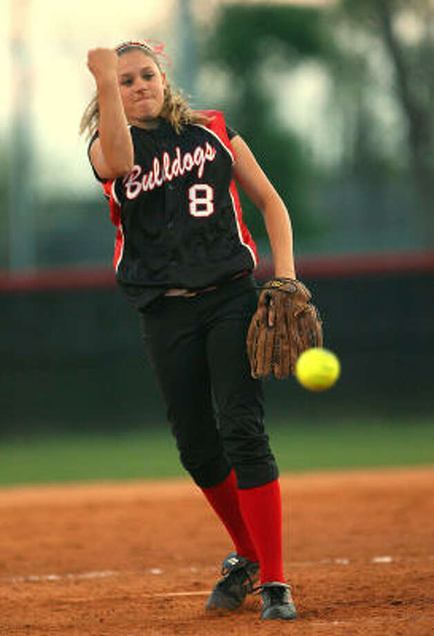 Austin pitcher Morgan Hawkins went 2-for-3 at the plate and had 10 strikeouts in the circle in a 4-2 win over Travis. Photo: Bob Levey, For The Chronicle