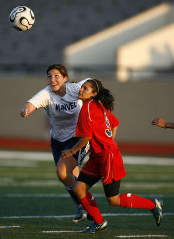 Goose Creek Memorial's Brittany Garza, right, scored a goal in a 2-0 win over Manvel. Photo: Sharon Steinmann, Chronicle