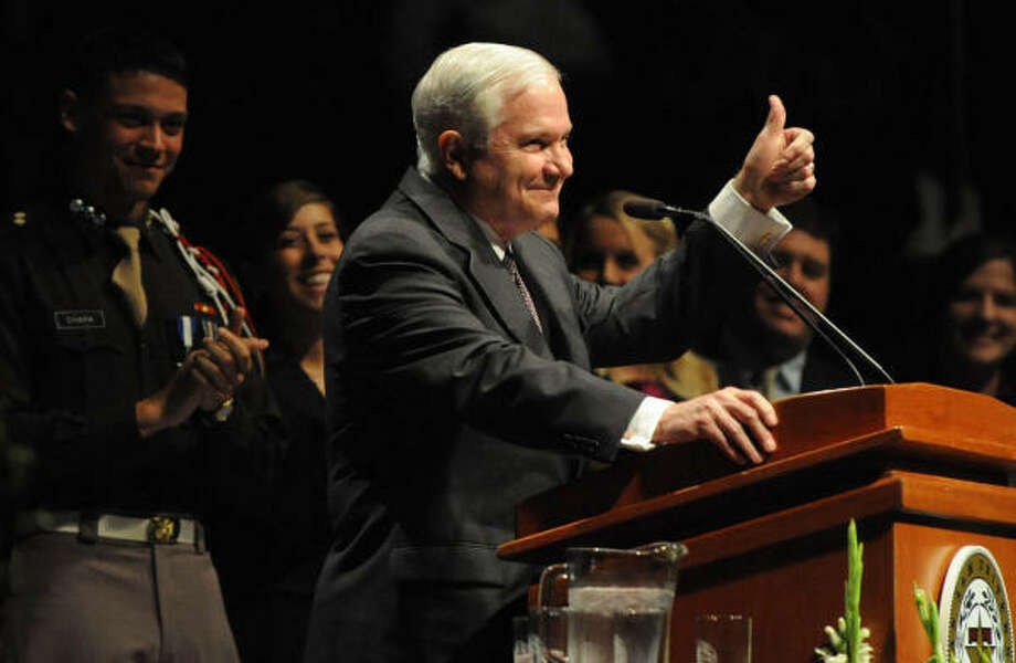Robert Gates, who spent seven years in Aggieland, began the annual roll call of fallen Aggies by reading the names of 22 former students who died in military action. Photo: Bryan/College Station Eagle