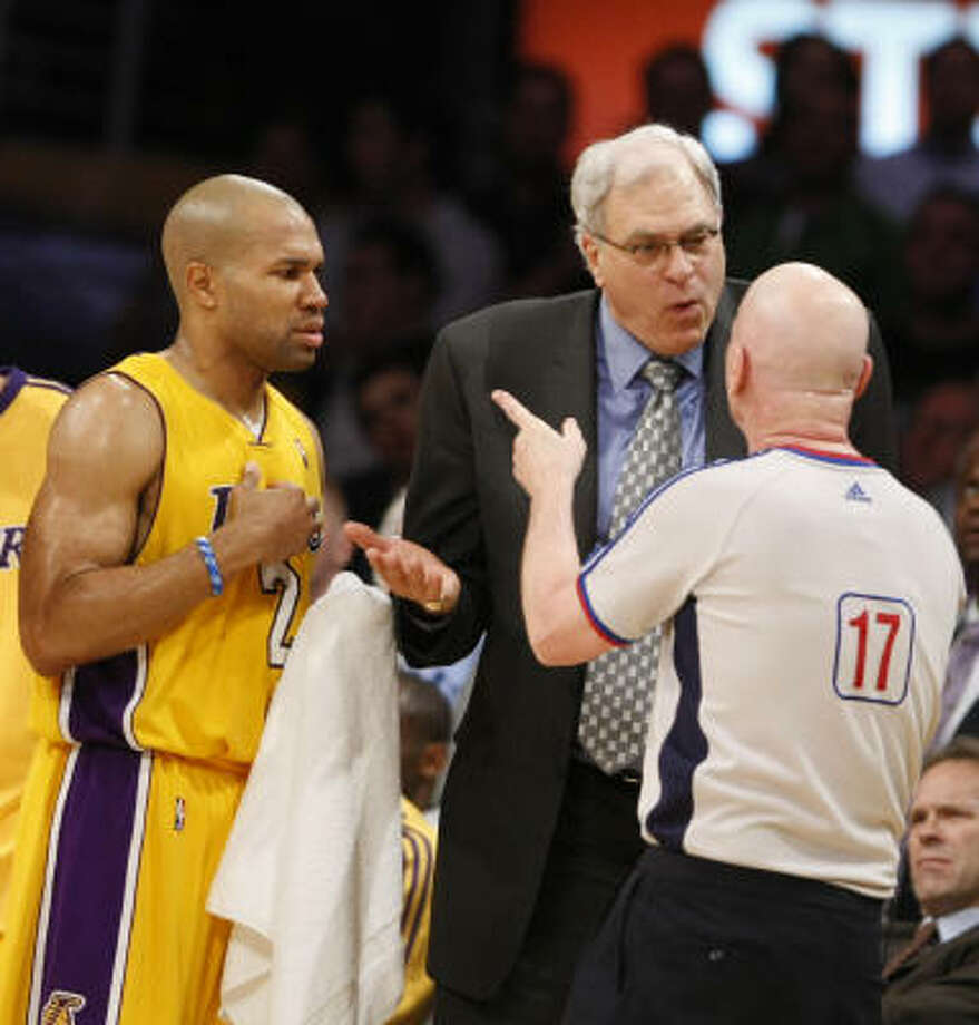 Los Angeles Lakers head coach Phil Jackson argues a foul called on guard Derek Fisher. Fisher was later given a one-game suspension for his Flagrant Foul Penalty-Two of Rockets forward Luis Scola. Photo: Nick De La Torre, Houston Chronicle