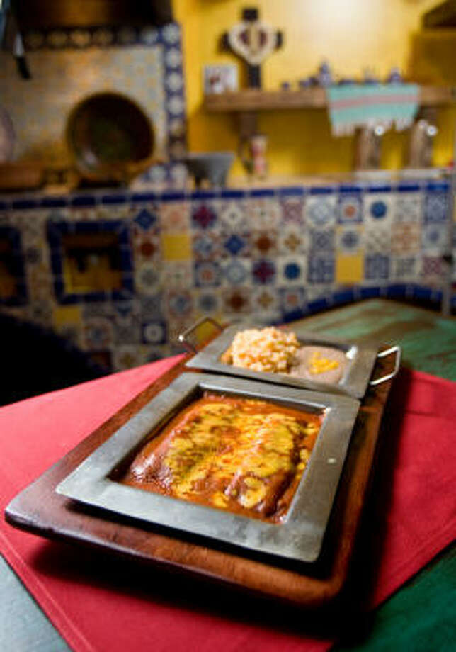 NICK de la TORRE : CHRONICLE break it up: Sylvia's Enchiladas Refugio plate was soaked in a bricky, dusky red-chile sauce. Photo: Nick De La Torre, Chronicle