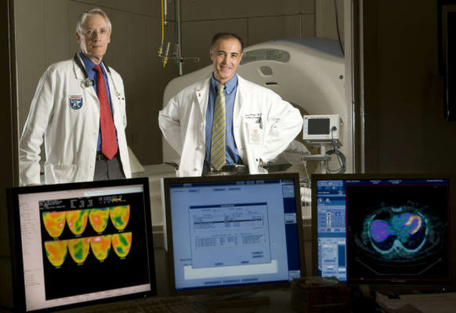 Dr. K. Lance Gould, left, and Dr. Stefano Sdringola believe patients who are receiving treatment for heart disease should also undergo long-term support and education about the benefits of diet and exercise. Photo: Brett Coomer, Chronicle