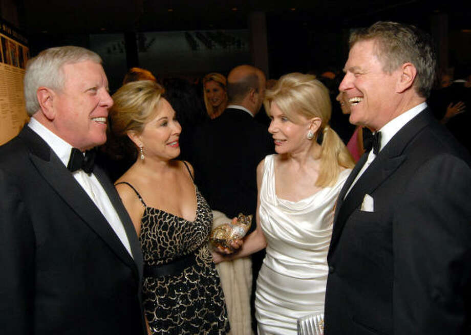 Rich and Nancy Kinder, left, congratulate Frances and Peter Marzio on the $1.3 million success of the Museum of Fine Arts, Houston Grand Gala Ball, held at the museum. Photo: Dave Rossman