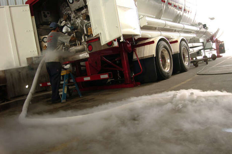 Stanley Mitchell Jr. transfers liquid nitrogen for Cryogenic Vessel Alternatives at its headquarters in Mont Belvieu. Photo: Chris Curry, Chronicle