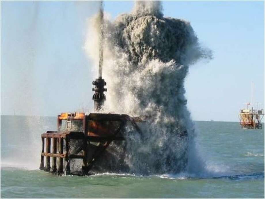 Explosives detonate as an drilling platform is removed. NOAA ensures endangered species are not harmed. Photo: NOAA