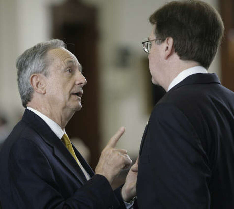 Sen. Jeff Wentworth, R-San Antonio, and Sen. Dan Patrick, R-Houston, talk about a redistricting proposal on March 23. Photo: Harry Cabluck, AP