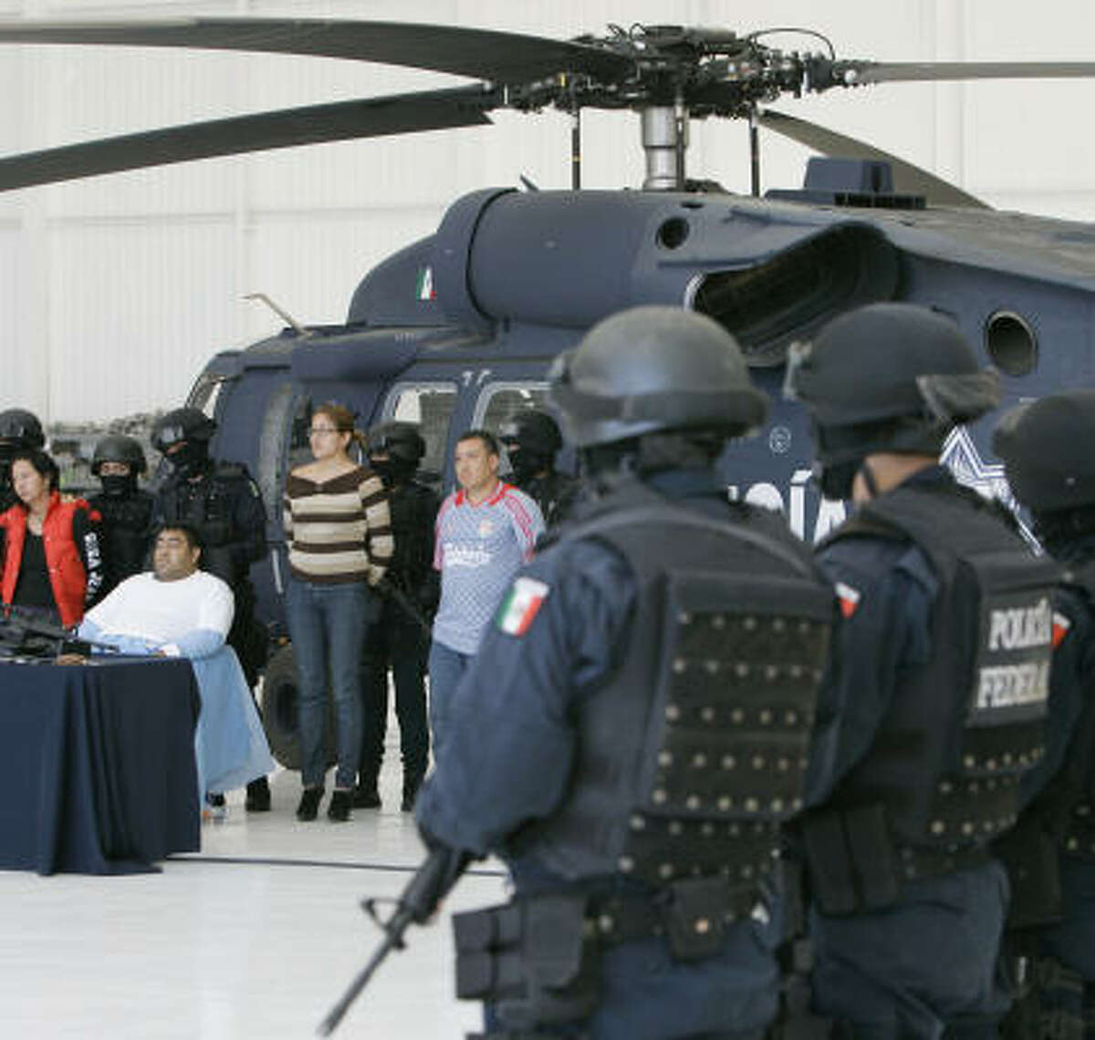 Suspects identified as belonging to Los Zetas are presented to the media after an arrest in last month in Mexico City.