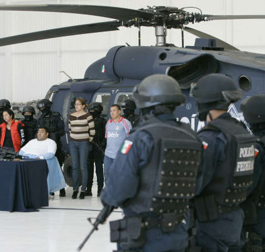 Suspects identified as belonging to Los Zetas are presented to the media after an arrest in last month in Mexico City. Photo: Miguel Tovar, AP