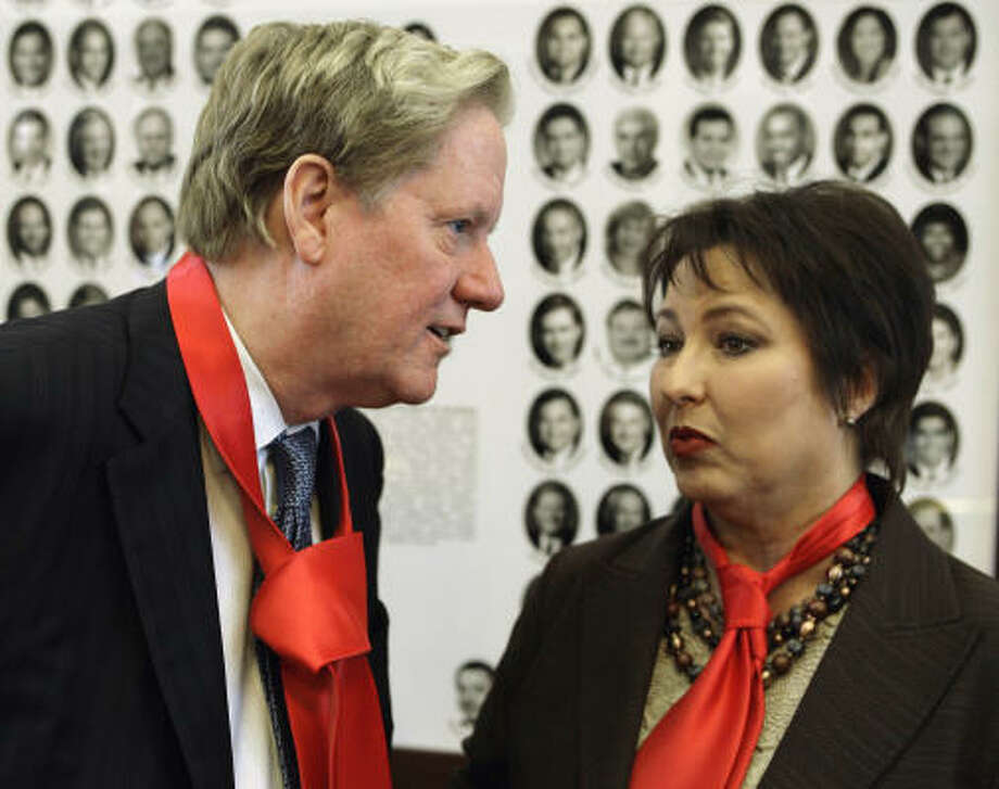 In an attempt at unity, the wife of Rep. Chuck Hopson, D-Jacksonville, supplied each House member with a sample of her husband's signature red neckwear. Here Rep. Jim Pitts, R-Waxahachie, and Rep. Vicki Truitt, R-Keller, get in the spirit on Tuesday. Photo: Harry Cabluck, AP