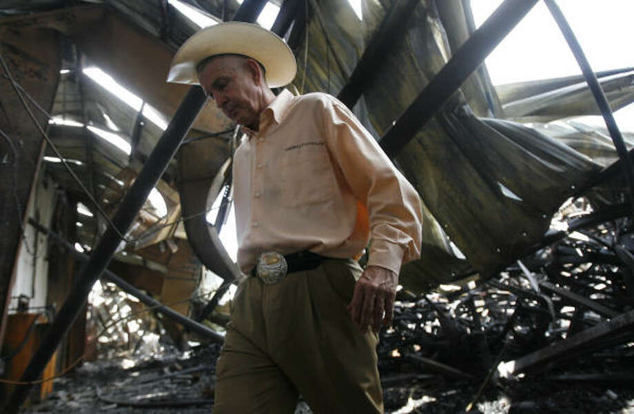 Gallery Furniture's Jim McIngvale leaves the gutted warehouse at the North Freeway location Thursday as he gives a tour to the media. Photo: MAYRA BELTRAN :, CHRONICLE