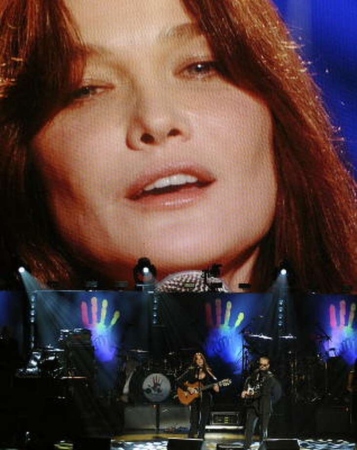 French First Lady Carla Bruni makes her American stage debut at the Mandela concert at Radio City Music Hall on Saturday. Photo: TIMOTHY A. CLARY, AFP/Getty Images