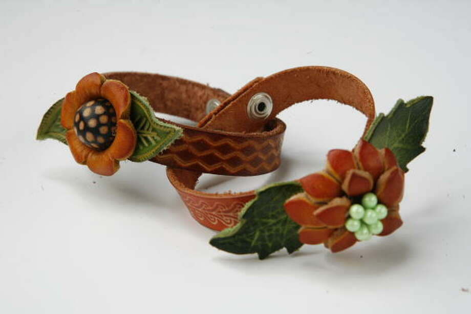 Leather floral bracelets, $6 each, from High Fashion Home. Photo: Julio Cortez, Houston Chronicle
