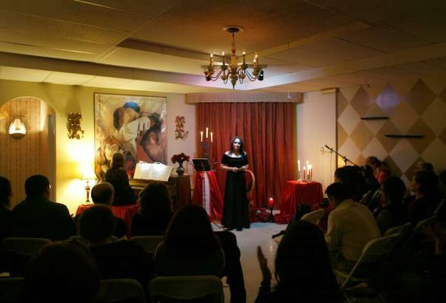 Zully Martinez performs for a group of opera lovers at a recital at the Cafe de la Opera in Tijuana, Mexico. The gatherings are an antidote to the violence that has rocked the city the last year. Photo: MICHAEL ROBINSON CHAVEZ, Los Angeles Times