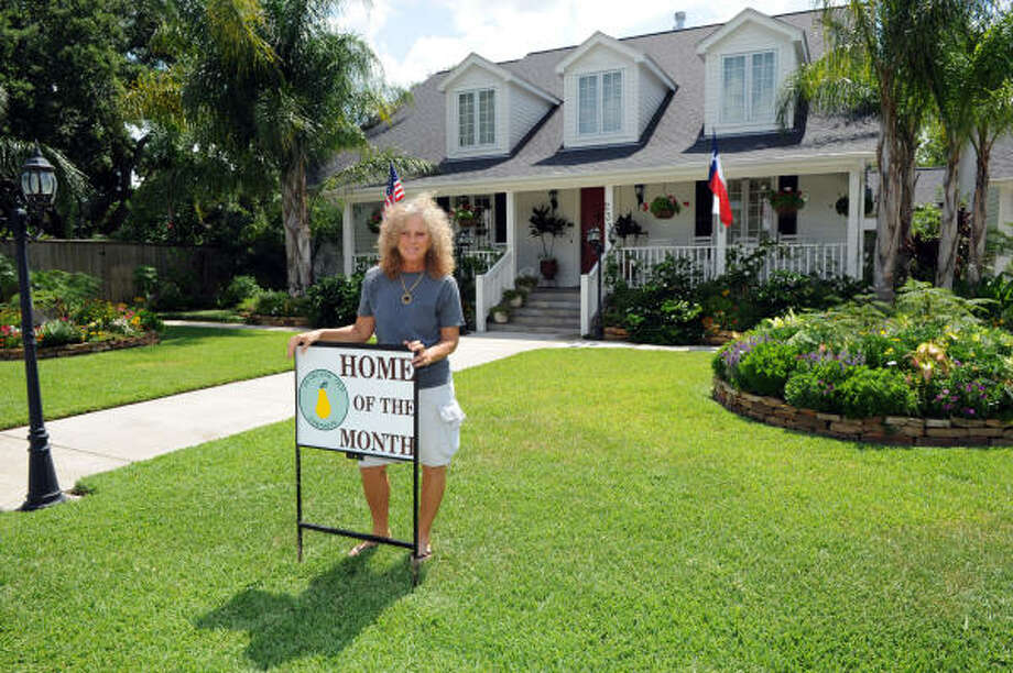 NICE YARD: Ruth LeClere stands in front of her home in Pearland's Old Townsite, Photo: Kim Christensen, For The Chronicle