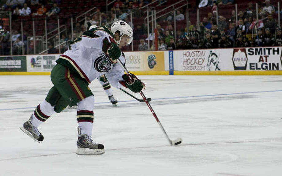 Aeros center Andy Hilbert makes a shot on goal during the second period. Photo: Nathan Lindstrom, For The Chronicle